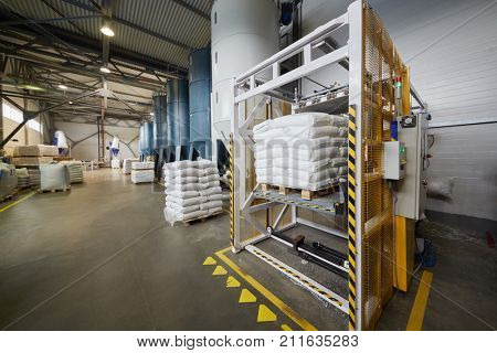 MOSCOW, RUSSIA - MAR 01, 2017: Workshop with polymer supply hoppers and pallets with polymer flakes at SINIKON factory. The joint Russian-Italian company Sinikon was founded in 1996.