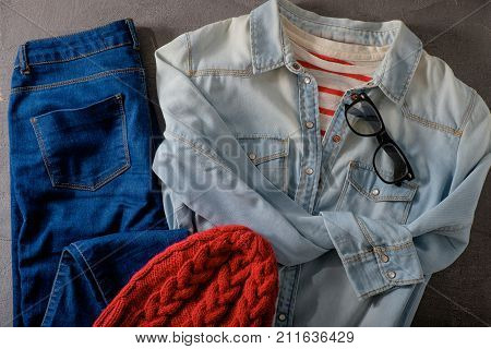 Outfit of clothes and woman accessories on gray wooden background