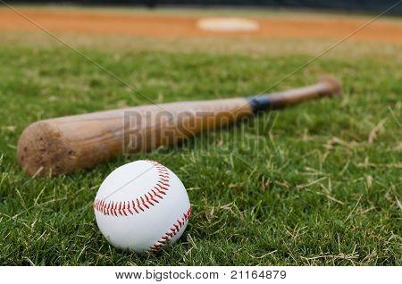 Baseball And Bat On Field
