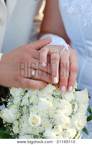 Hands of bride and fiance