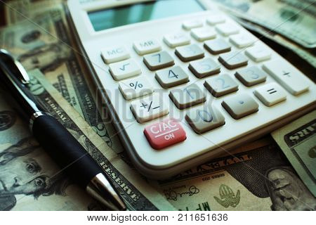 Calculator On Stacks Of Money High Quality