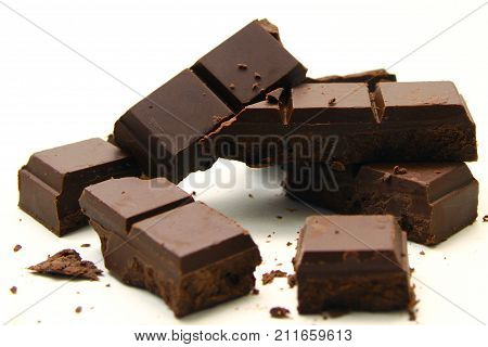 Chocolate bar background / A chocolate bar is a chocolate confection in an oblong or rectangular form, which distinguishes it from bulk chocolate produced for commercial use or individually portioned chocolates poster
