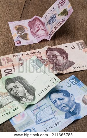 Bills of 20 50 200 and 500 mexican pesos seems to be sad perhaps because of its weakness against the dollar.