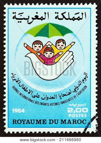 MOROCCO - CIRCA 1984: A stamp printed in Morocco issued for the International Child victims day shows Children and dove, circa 1984.