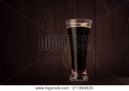Weizen beer glass porter or red ale on dark wood board copy space. Template for advertising design branding identity restaurant menu cover.