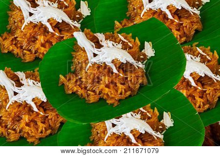Brown Sticky Rice Sweet With Coconut On Banana Leave