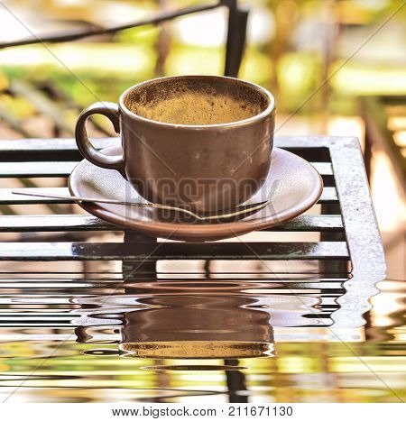 Coffee Cup With Froth On Table With Reflect