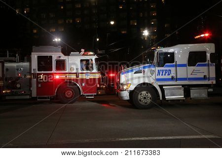 NEW YORK - OCTOBER 31, 2017: NYPD truck and FDNY firetruck at the crime scene near a terror attack site in lower Manhattan in New York.