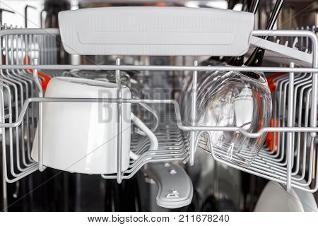 Open dishwasher with clean glass and dishes, selective focus, Clean glasses after washing in the dishwasher.