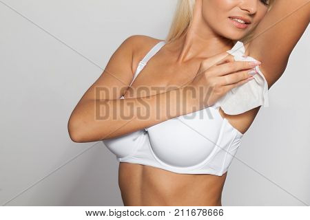 Woman wiping the armpit with wet wipes, perspiration, sweat