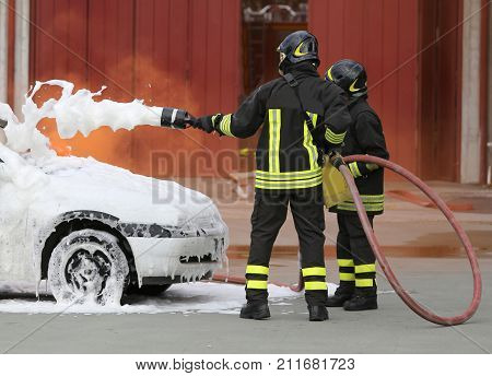 Brave Firefighters With Foaming Fire Off The Car Fire After The