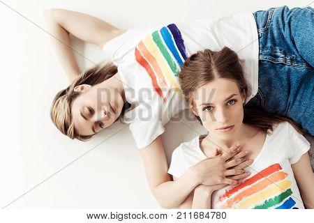 Woman Lying On Girlfriends Belly