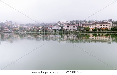 SAPA LAO CAI VIETNAM - OCTOBER 2017 : Panorama Sapa Vietnam is a reflection of water from the lake in the town of Sapa. In the background is Mountain. Fog floating over the city