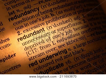 CLECKHEATON, WEST YORKSHIRE, UK: CLOSE UP OF DICTIONARY PAGE SHOWING DEFINITION OF THE WORD REDUNDANT 3RD AUGUST 2004 CLECKHEATON, WEST YORKSHIRE, UK