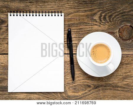 Open Notepad With Spiral, Pen And Coffee Cup