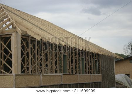 The house is made of a light adobe. Frame-adobe technology. Filling under formwork. Fasade. Roof