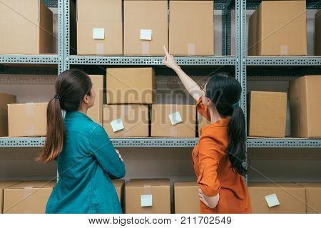 Online Shopping Company Workers Looking At Box