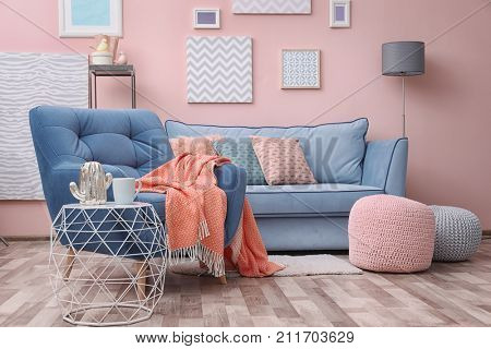 Modern living room interior with blue armchair