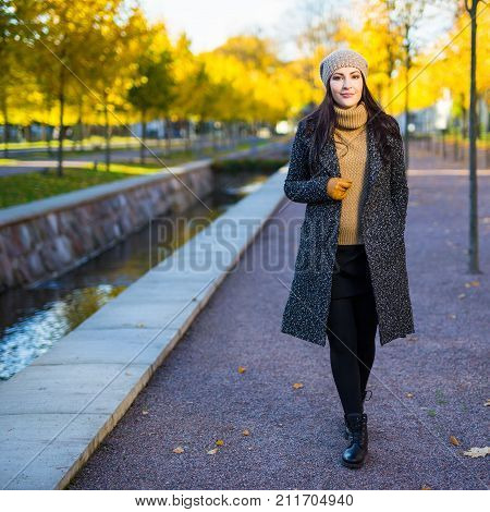 Happy Attractive Woman Walking In Autumn Park