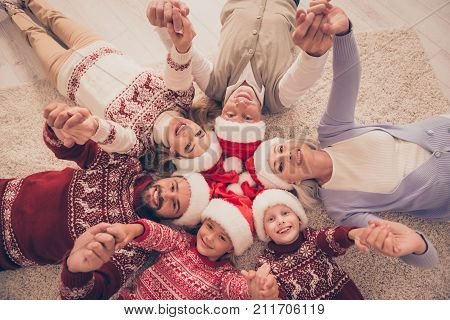 High Angle Of Six Gathered Cheerful Relatives On Carpet, Married Couples, Excited Siblings, Grandad,