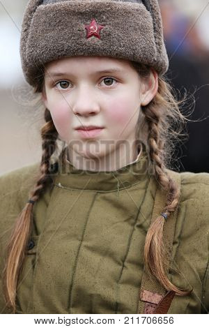 Belarus Gomel November 21 2016 Reconstruction of the battle for World War II. Children are the second world of war. A girl of soldiers.