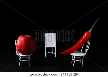 It looks like that is job interview with vegetables and fruits