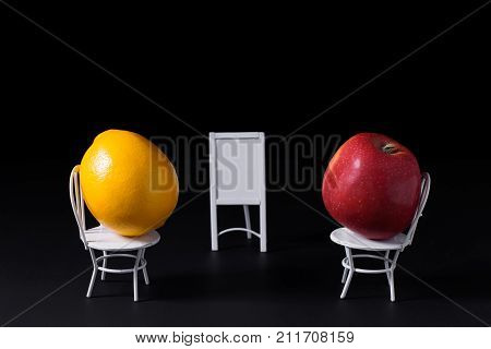 This looks as a lemon is training a apple or making a presentation