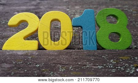 Happy New Year 2018. Numbers forming the number 2018, For the new year 2018 on rustic wooden table