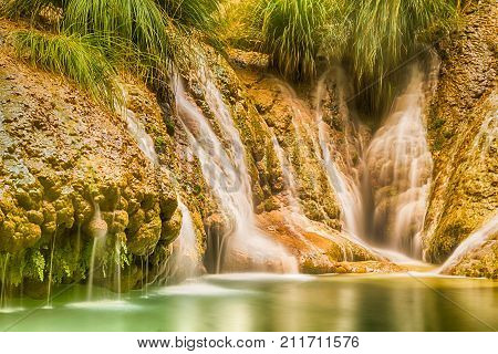 Famous waterfalls Polilimnio in Greece. An artistic view.