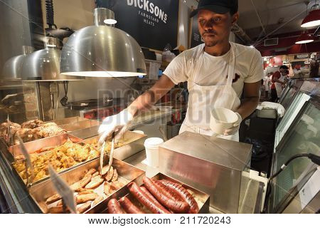 NEW YORK CITY - AUG. 29 : Unidentified people trades traditional food on August 29 2017 in Chelsea Market New York City NY. Chelsea Market is a food hall and shopping mall located in the Chelsea neighborhood.