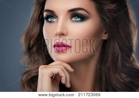 Gorgeous Woman With Beautiful Makeup And Hairdo