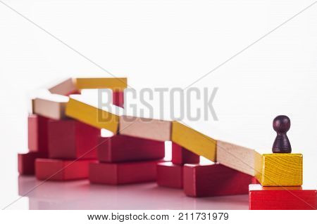 Abstract man on top of a wooden construction the concept of a career competition career ladder business learning success business hierarchy. Achieving success. Social status business metaphor.