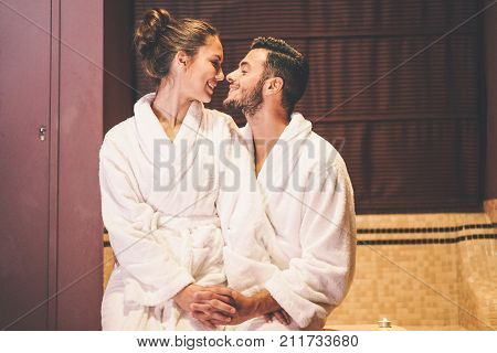 Loving couple story having a passion moment in their vacation honeymoon - Embrace romantic lovers kissing - Romance intimate relationship concept - Soft focus on male face