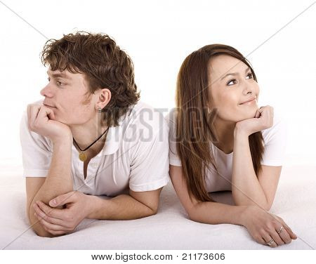 Man and the woman look every which way. Isolated.