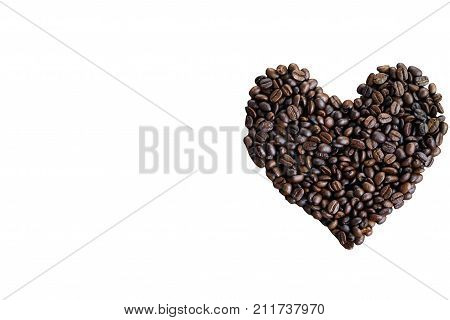 White isolated with clipping paths lovely heart shape from roasted coffee beans in top view flat lay. Love theme concept by coffee beans for Valentine's with copy space for background and wallpaper. Cute heart from roasted coffee beans on white isolated b