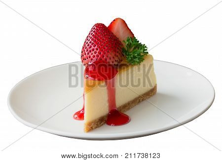 White isolated background with clipping paths homemade New York cheesecake on white plate decorated strawberry parsley and strawberry sauce. Delicious moist and smooth baked strawberry cheesecake. Strawberry cheese cake on white isolated background.