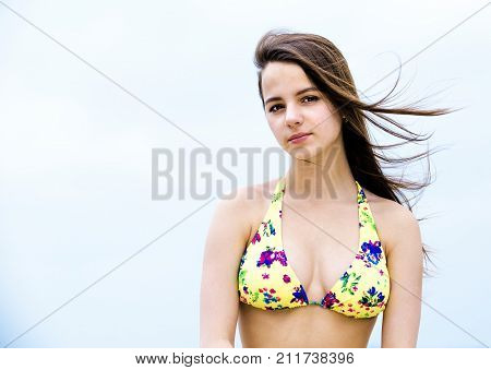 Attractive woman at the resort. He looks at the camera.