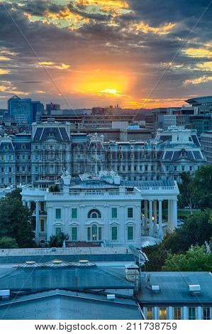 September 12 2017 Washington DC USA: The US Treasury building White House and Eisenhower Executive Office building at sunset as seen from the roof top of a near by building.