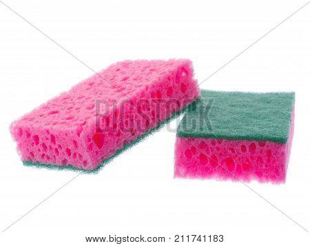 One sponge lies on an inverted sponge on a white isolated background