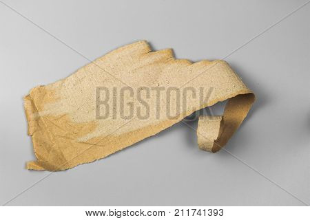paper cut. old paper of Packaging box isolated on gray background. brown paper rip