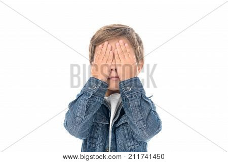 Little Boy Covering Eyes With Hands