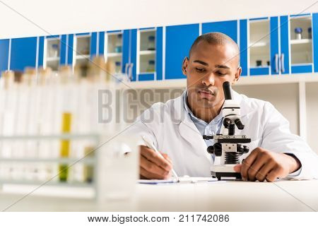 Technician Doing Microscope Analysis