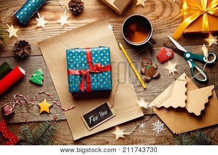 Beautiful Christmas Background With With New Year Décor, A Sheet Of Old Paper, Garland And Gifts, Gi