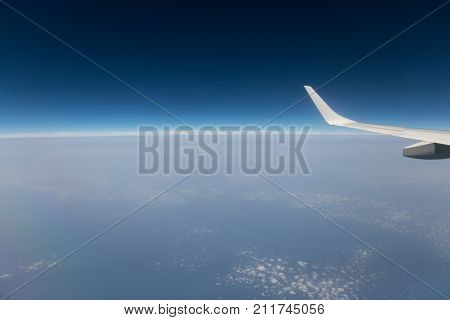 view from the airplane window cloud wing dimensions