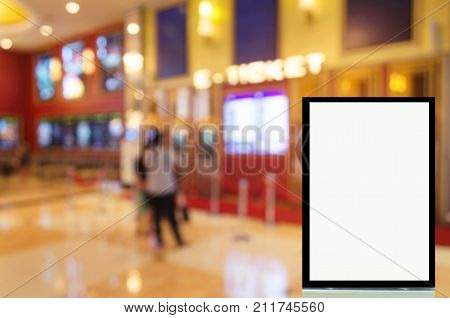 advertising billboard or blank showcase light box for your text message or media content with people buy cinema tickets from automatic ticket machine at movie theater commercial and marketing concept