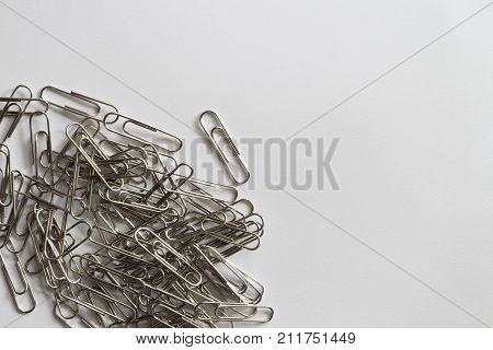Paper clips on grunge white paper background