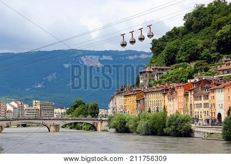 Isere river and cable car in the center of Grenoble, France