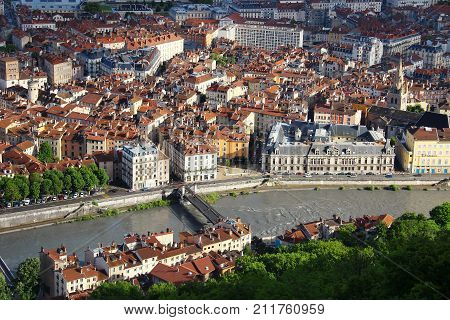 Aerial view of Grenoble old town and bridge over Isere river, France