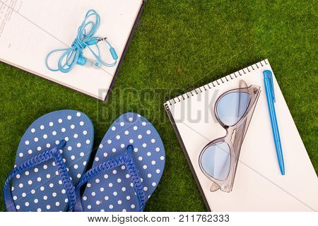 Female Fashion Accessories - Flip Flops, Book, Note Pad, Pen, Headphones, Note Pad, Sunglasses On Th