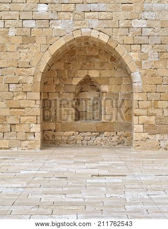 Stone wall with embedded niche Exterior wall at the corridors surrounding Alexandria castle